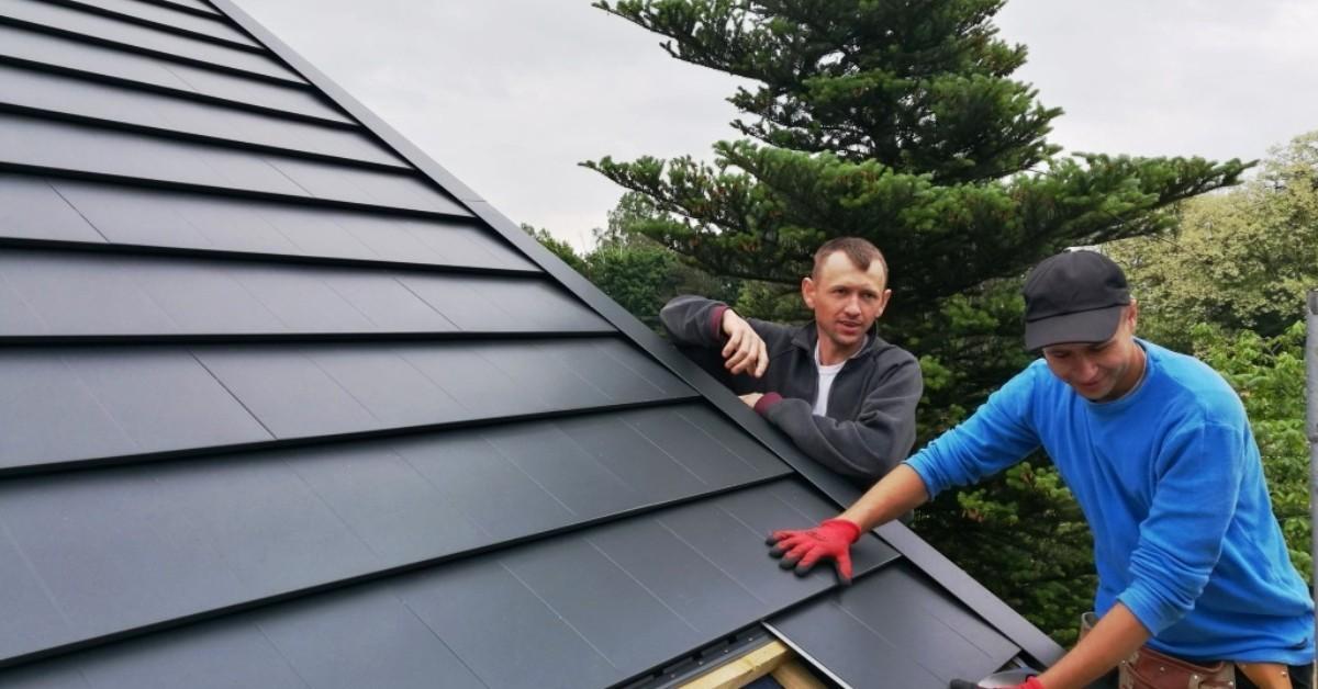 Workers Installing Concealed Fastener Metal Roofing